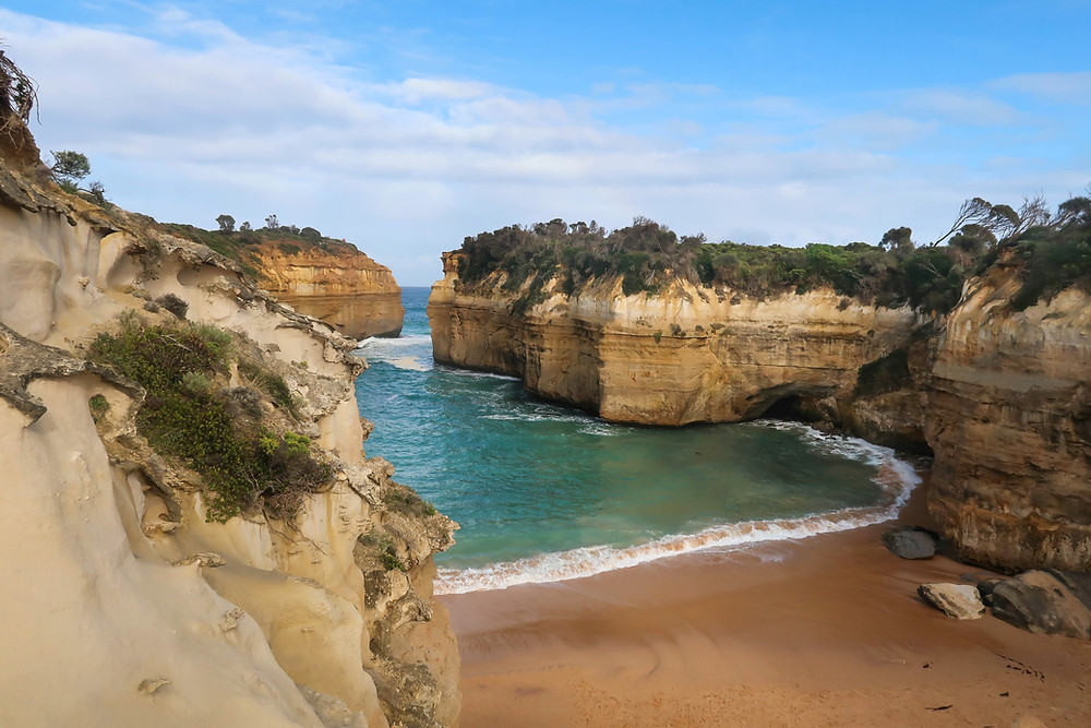 View overlooking Loch Ard Gorge located along the Great Ocean Road in Victoria South Australia, view of the ocean, limestone stacks, Australia's shipwreck coast, parched around the world