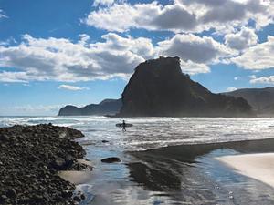 Black sand beaches of new Zealand near Auckland in north island, piha beach, lion rock, surfer's paradise