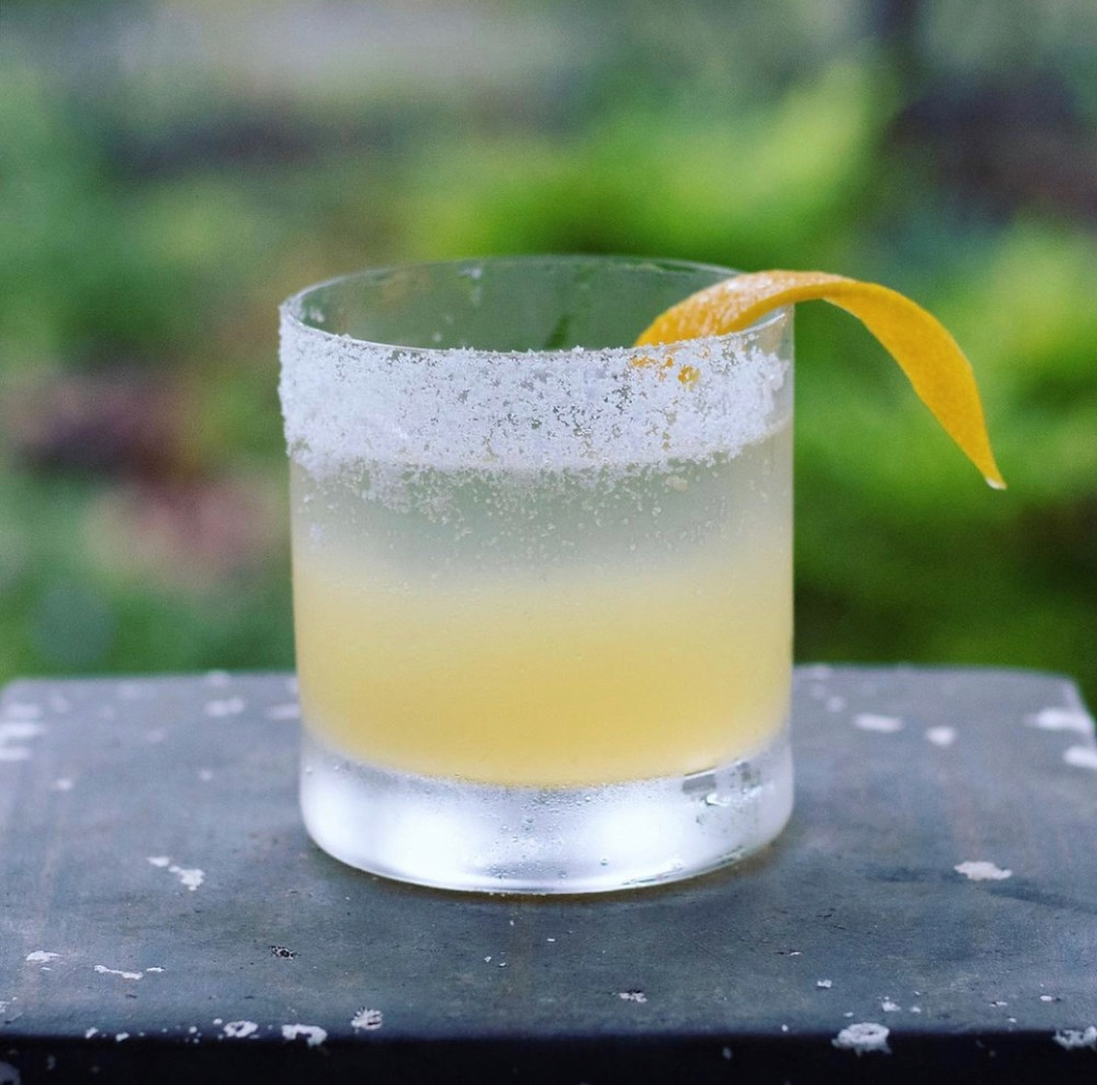 Classic margarita in a salt-rimmed glass garnished with an orange twist, simple margarita recipe, cocktails with tequila, best cocktails