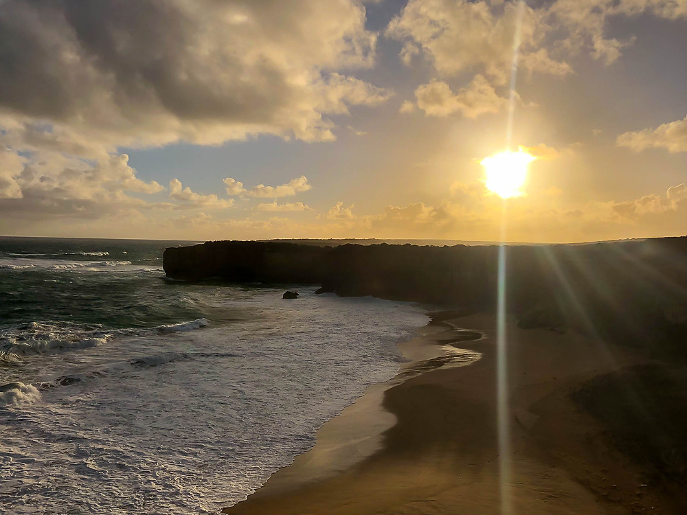 sunset over the southern ocean from the viewing platform at london bridge along australia's great ocean road, visit victoria, travel australia