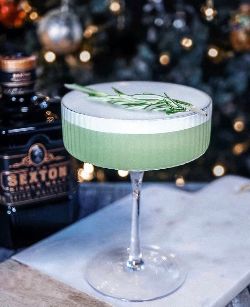 Mint green whiskey and gin cocktail, holiday cocktails, holiday cocktails with whiskey, best holiday cocktails, cocktails with gin, egg white cocktails