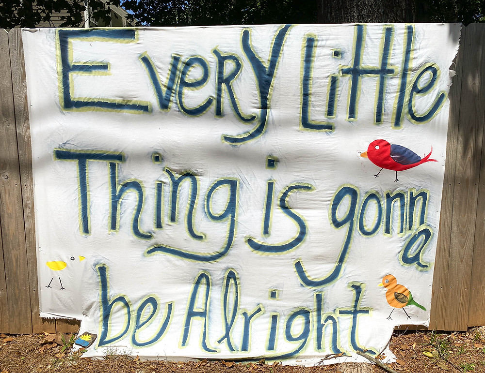 hand painted Every little thing is gonna be alright banner hanging on a fence during COVID-19 quarantine in Marietta Georgia, people helping people, lend a helping hand, support one another