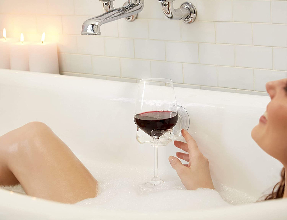a wine glass holder that suction cups to your bathtub or shower wall