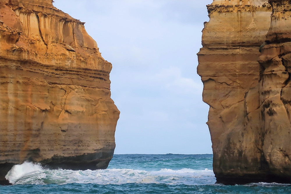 where to stop along the great ocean road in australia, south australia, loch ard gorge shipwreck of 1878, close up view of the limestone stacks at loch ard gorge where blowholes form in the ocean