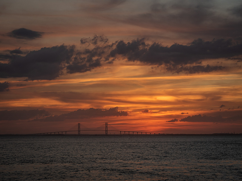 gold and orange sunset in st. simons island georgia, best summer songs of all time