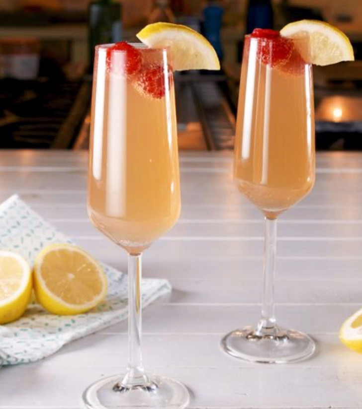 Mimosa garnished with raspberries and lemon, mimosa recipe, what is a mimosa, cocktail recipes with champagne, best mother's day cocktails