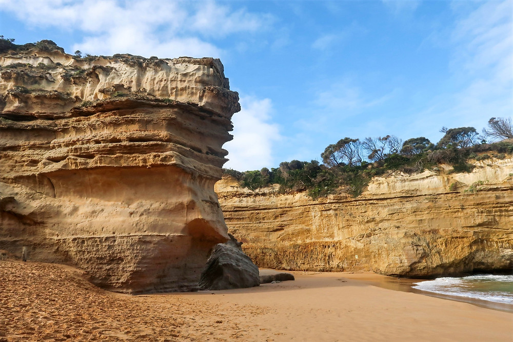 large rock formations on the beach of loch ard gorge, where to travel during winter in australia