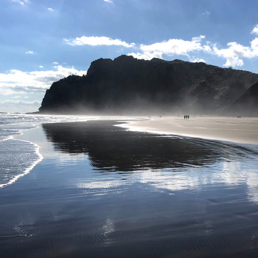 Where can you find black sand in new zealand?