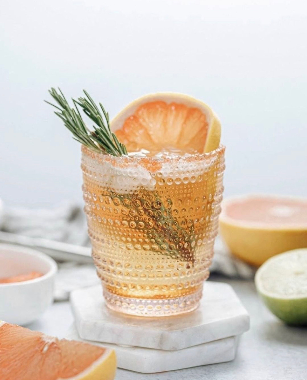 Margarita in a hobnob glass garnished with rosemary and grapefruit, cocktails with sparkling wine, tequila cocktails, easy cocktail recipes