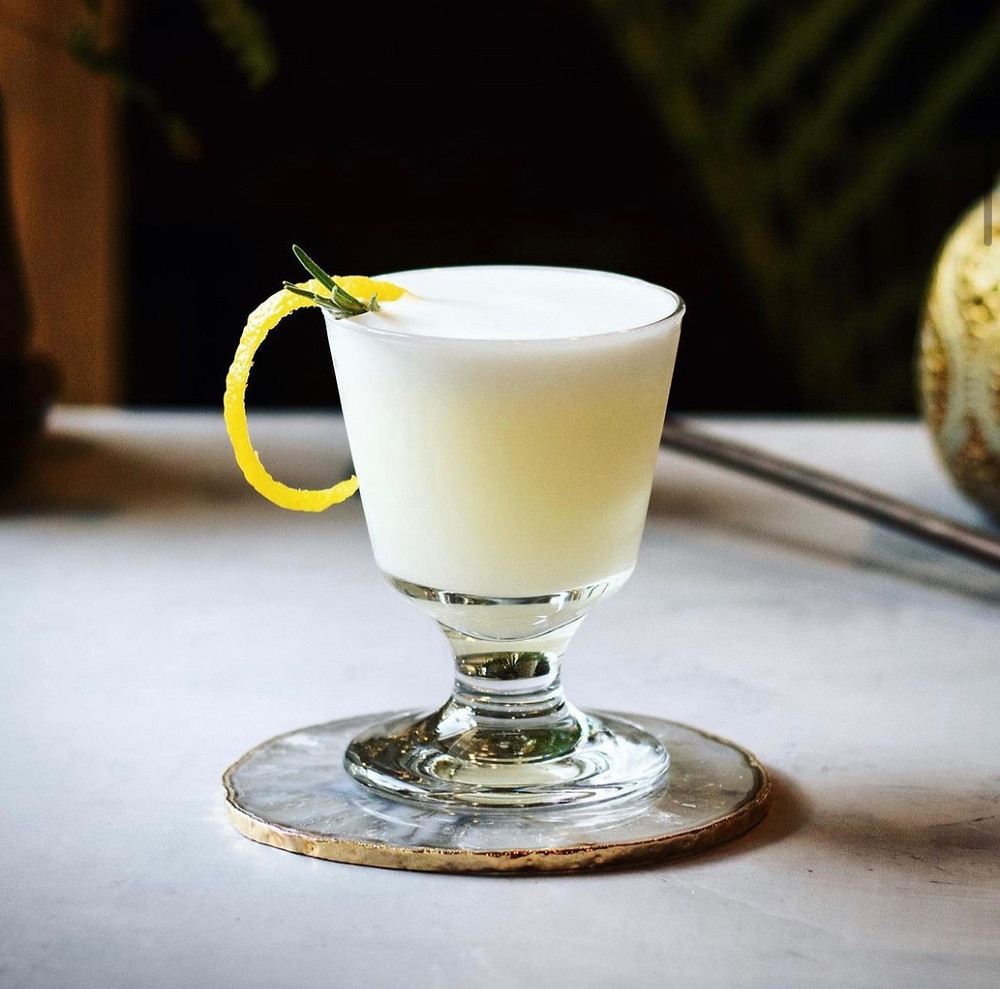 Gin sour garnished with a lemon twist and rosemary, easy cocktail recipes, best summer cocktail recipes, gin sour recipe, how to make a gin sour