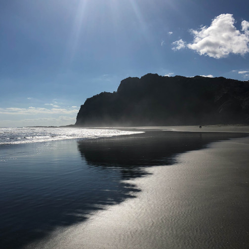 rock formations at karekare beach, natural beauty, isolated beaches of new zealand, off the beaten path new zealand destinations