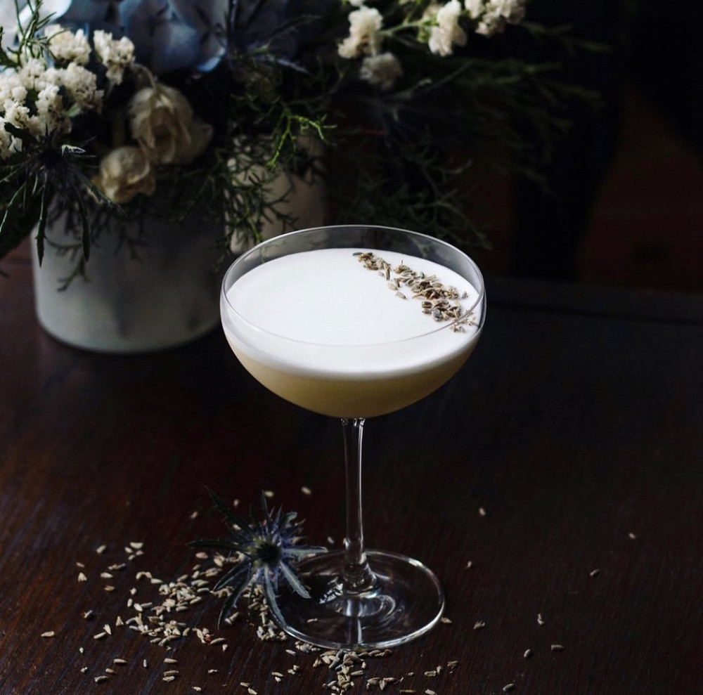Gin sour garnished with a dried lavender, best summer cocktail recipes, gin sour recipe, how to make a gin sour, cocktails with egg white