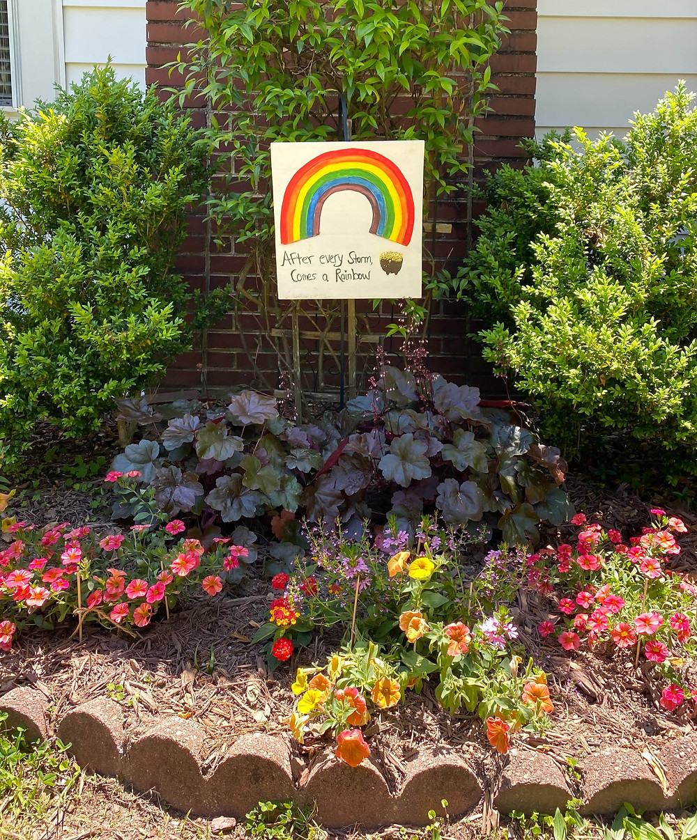 Handmade painted rainbow sign put outside by neighbors during the Coronavirus in Marietta Georgia on Stewart Avenue, kindness, support, encouragement
