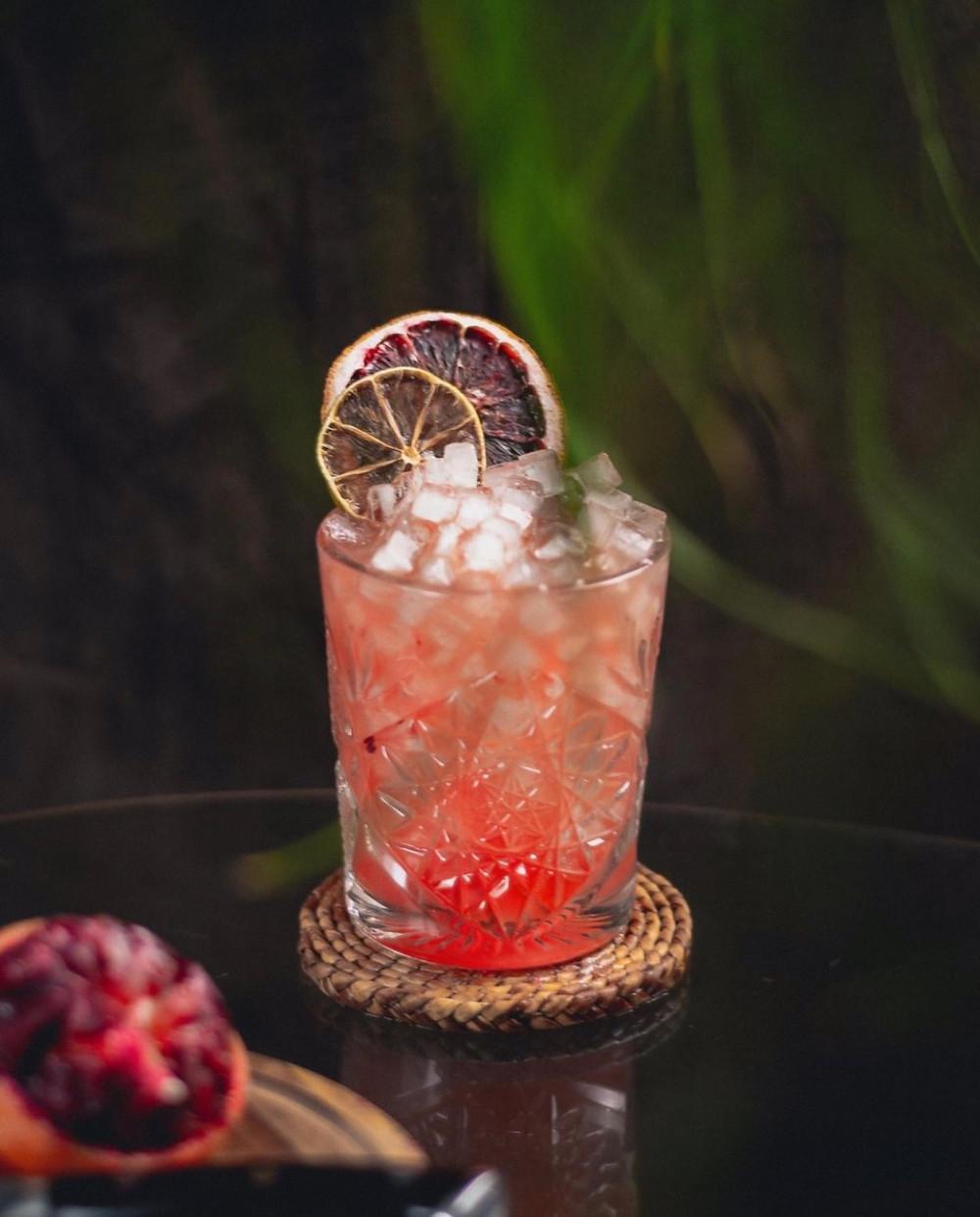 Rum-based tiki drink garnished with citrus wheels, best tiki drinks, best summer cocktail recipes, banana liqueur drinks, cocktail recipes with rum