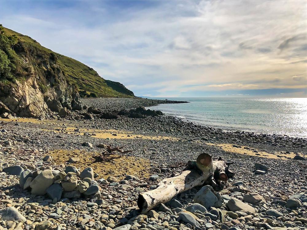 on the pebble beach of rotokura cable bay south island new zealand, rocky beach, shingle beach, photo essay, travel, beaches of new zealand