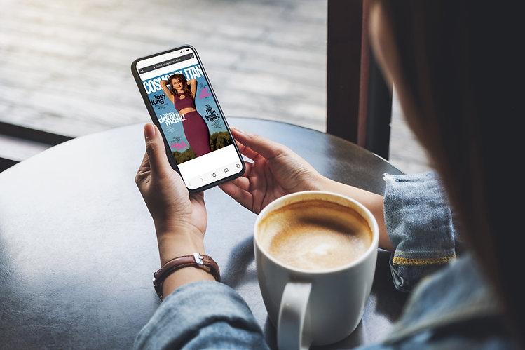 emags-rewards-woman-reading-phone.jpg