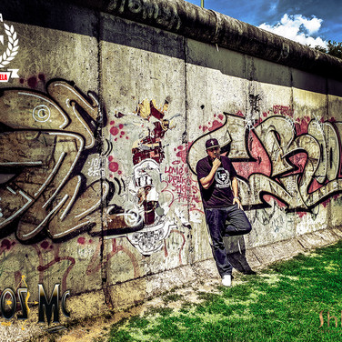 Kaos Mc at the Berlin Wall