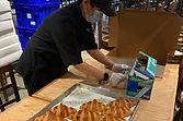 Elaine wrapping croissants.jpeg