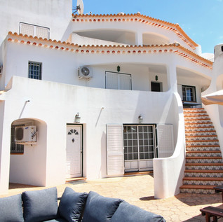 side of villa, stairs to lounge