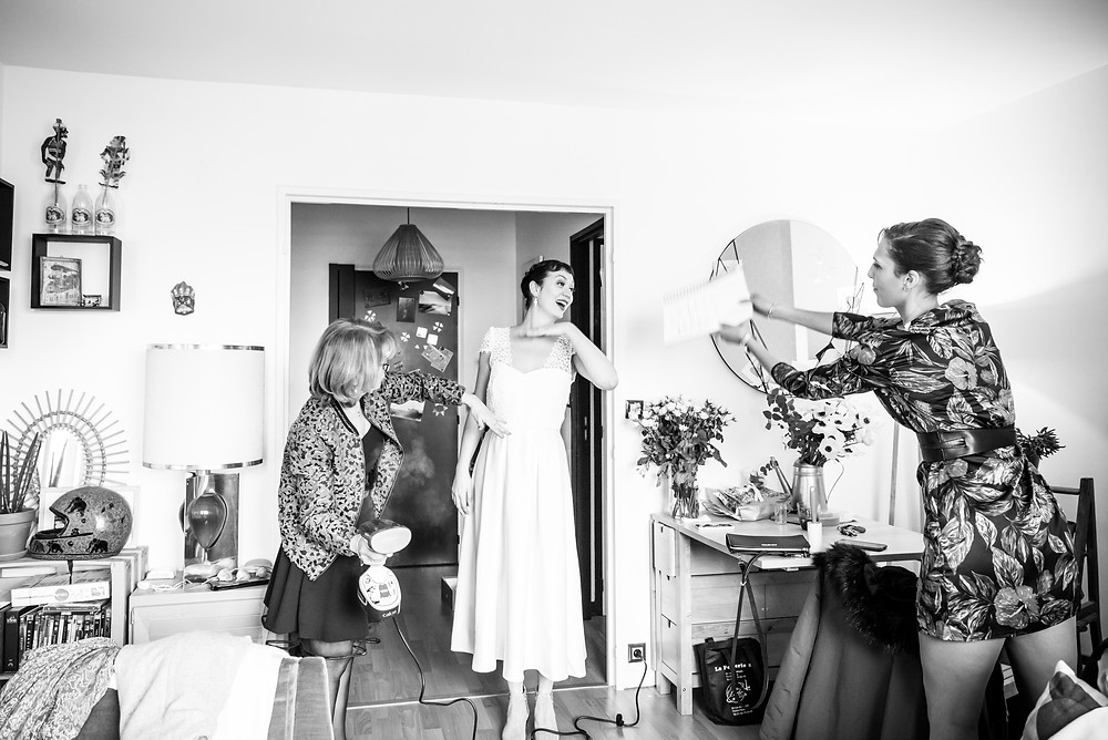 Photographe mariage Paris préparatifs robe mariée