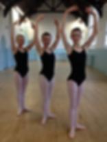Ballet students posing in studio