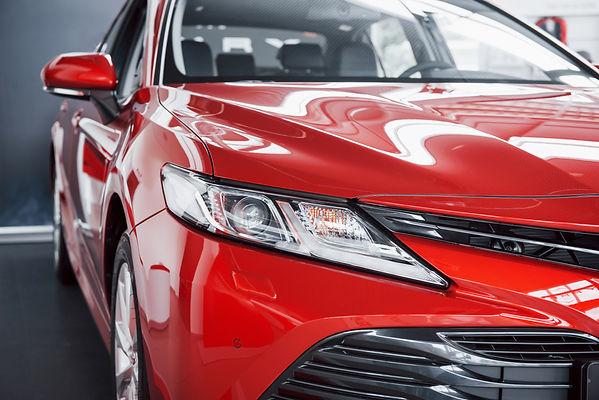 headlights-new-red-car-car-dealership.jp