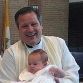 Father Stefan with baby.jpg