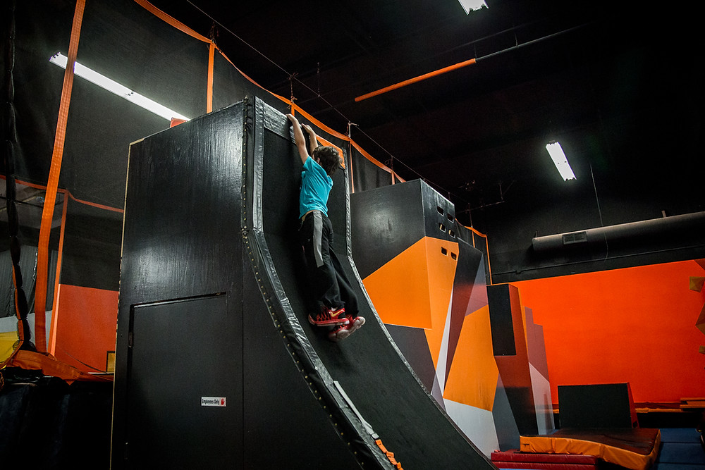 Kid crushing a warped wall at Skyhook Ninja Fitness in Portland, Oregon.