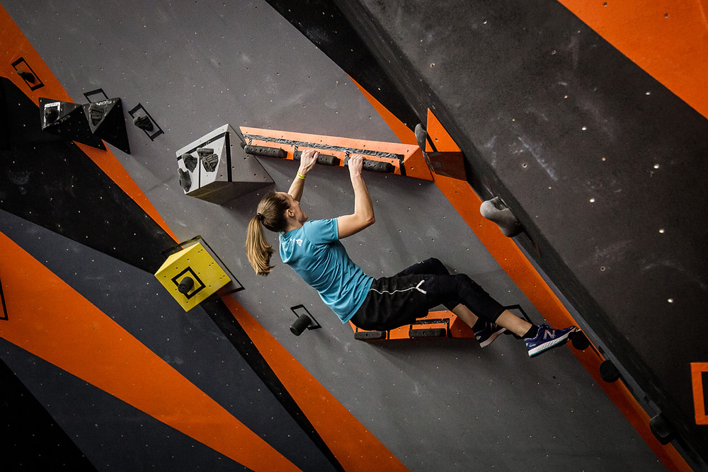 Skyhook Ninja Climbing on a climbing wall during a competition at Skyhook Ninja Fitness