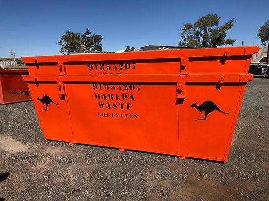 Photo of a Marlpa Waste Logistics skip painted orange