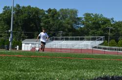 Christian running onto ball