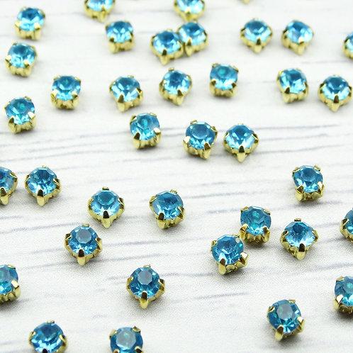 ЗЦ004НН44 Хрустальные стразы Ярко-голубые в металлических цапах (золото) 4х4мм.