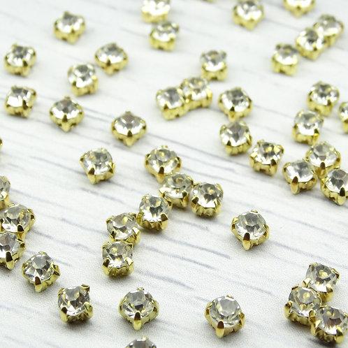 ЗЦ001НН44 Хрустальные стразы Белые в металлических цапах (золото), 4х4мм.