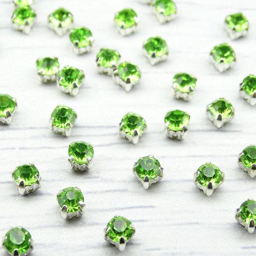 СЦ015НН44 Хрустальные стразы Зеленые в металлических цапах (серебро), 4х4мм.