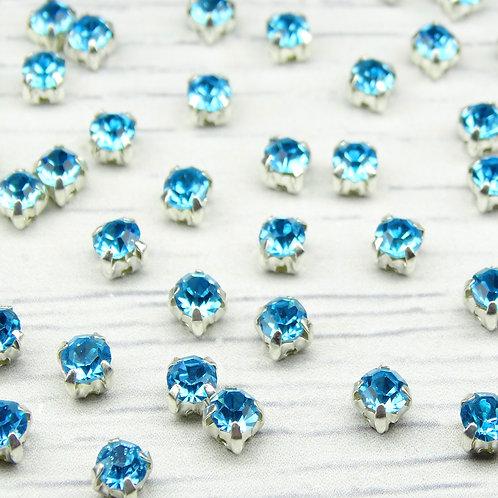 СЦ004НН44 Хрустальные стразы Ярко-голубой в металлических цапах (серебро), 4х4мм