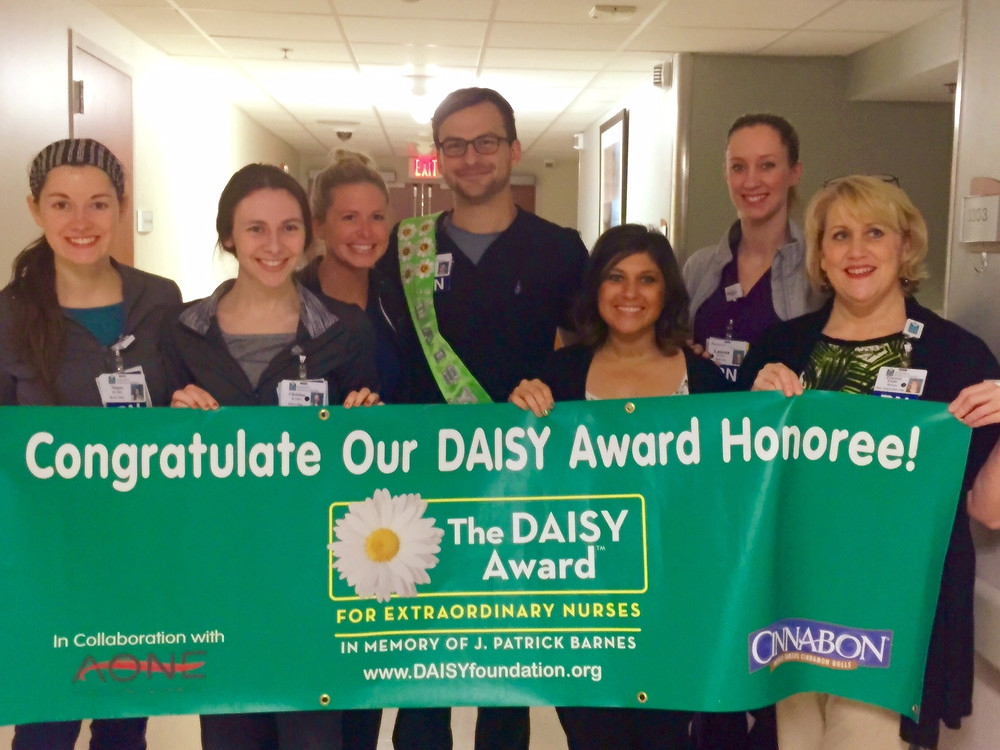 Pictured center: Daisy Award Honoree Alex Linderer, RN
