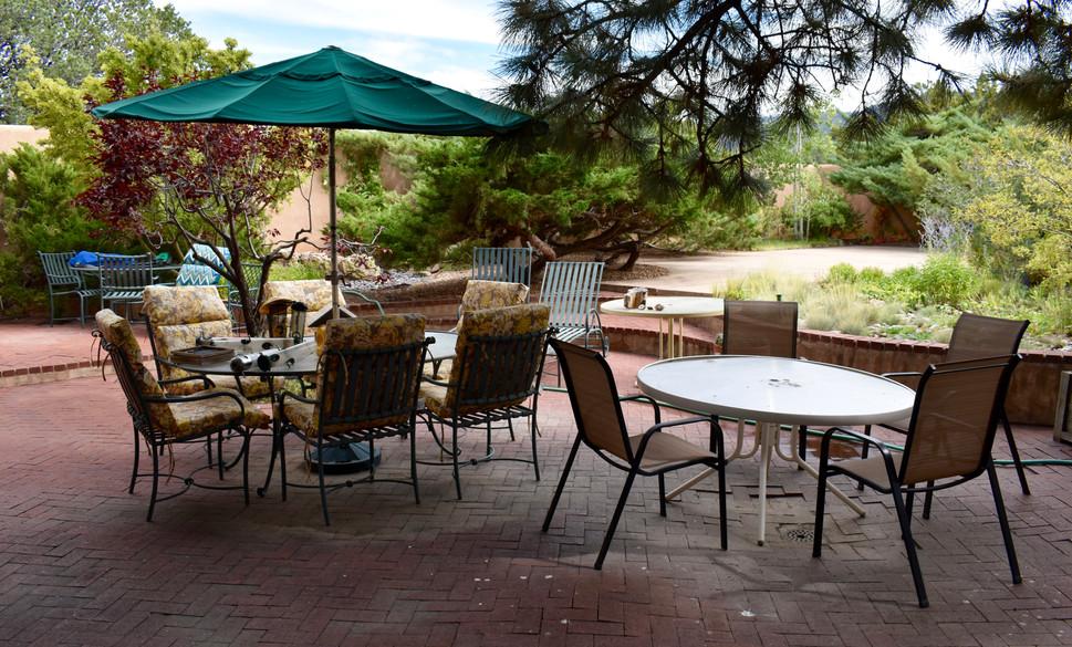 Mulitple outdoor patio sets.