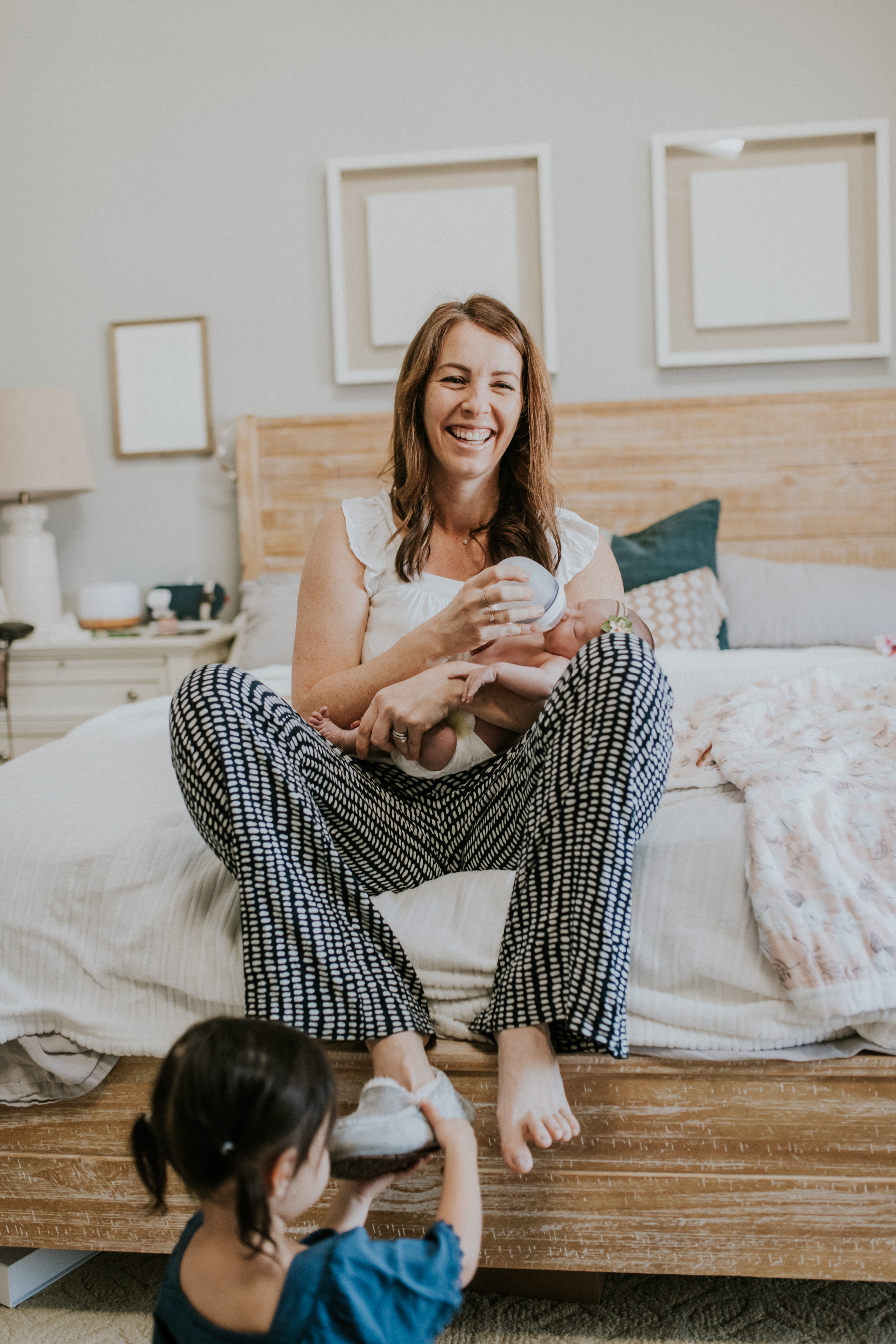 mom holding baby candid at home lifestyle newborn photography los angeles california