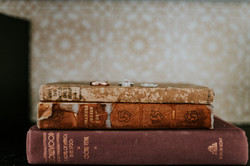 wedding rings on books detail wedding photography colony palms palm springs
