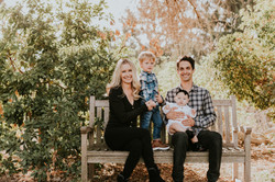 family posed on a bench in park family photography los angeles california