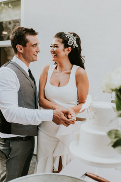bride and groom cutting the cake courthouse small wedding day photography california wedding photogr