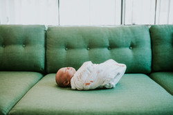baby on green couch at home lifestyle newborn photography los angeles california