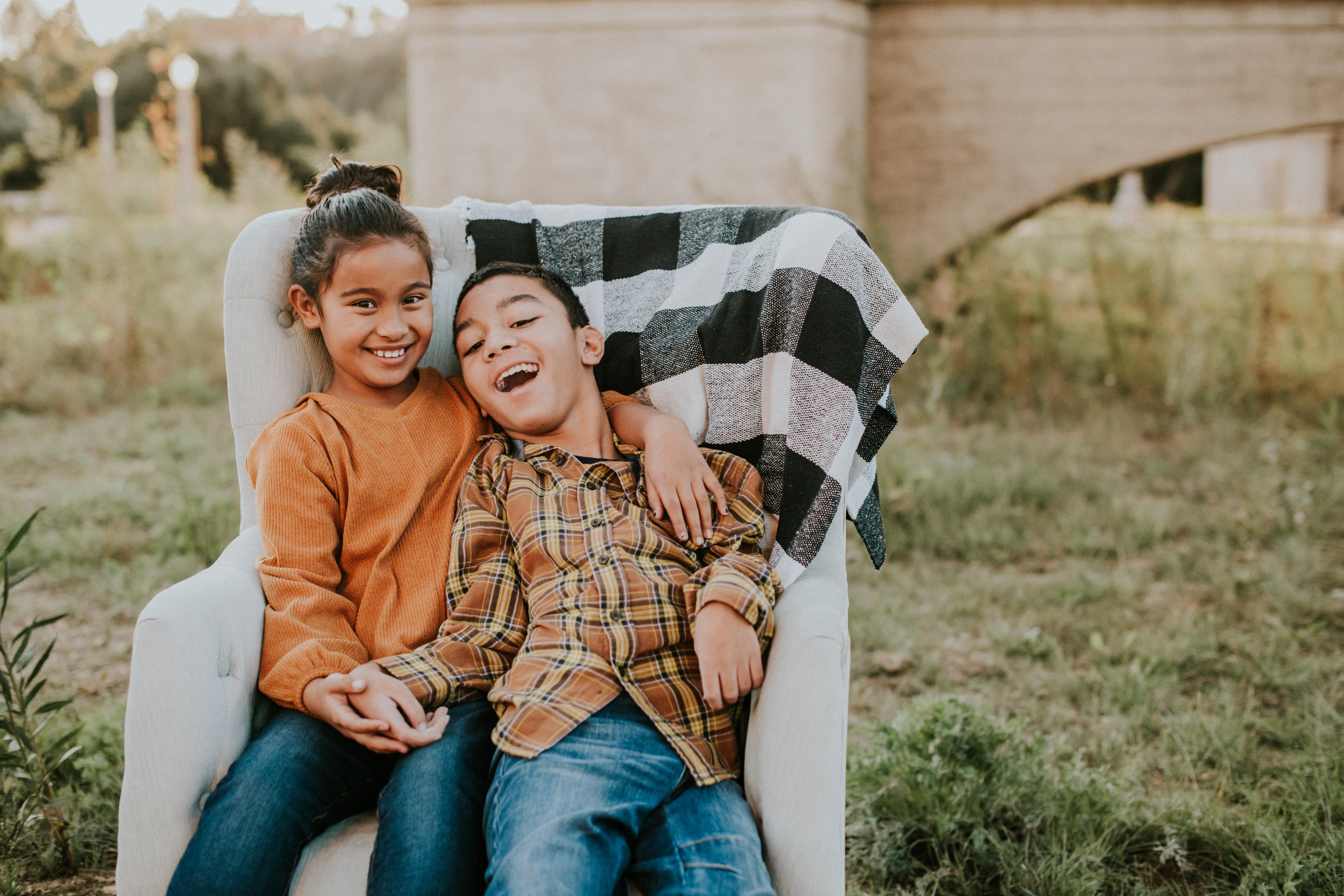 brother and sister posed under bridge fall photos family photography pasadena california