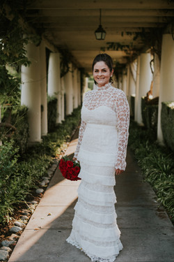 bride posed in wedding dress and red roses bouquet wedding day photography at the langham pasadena c