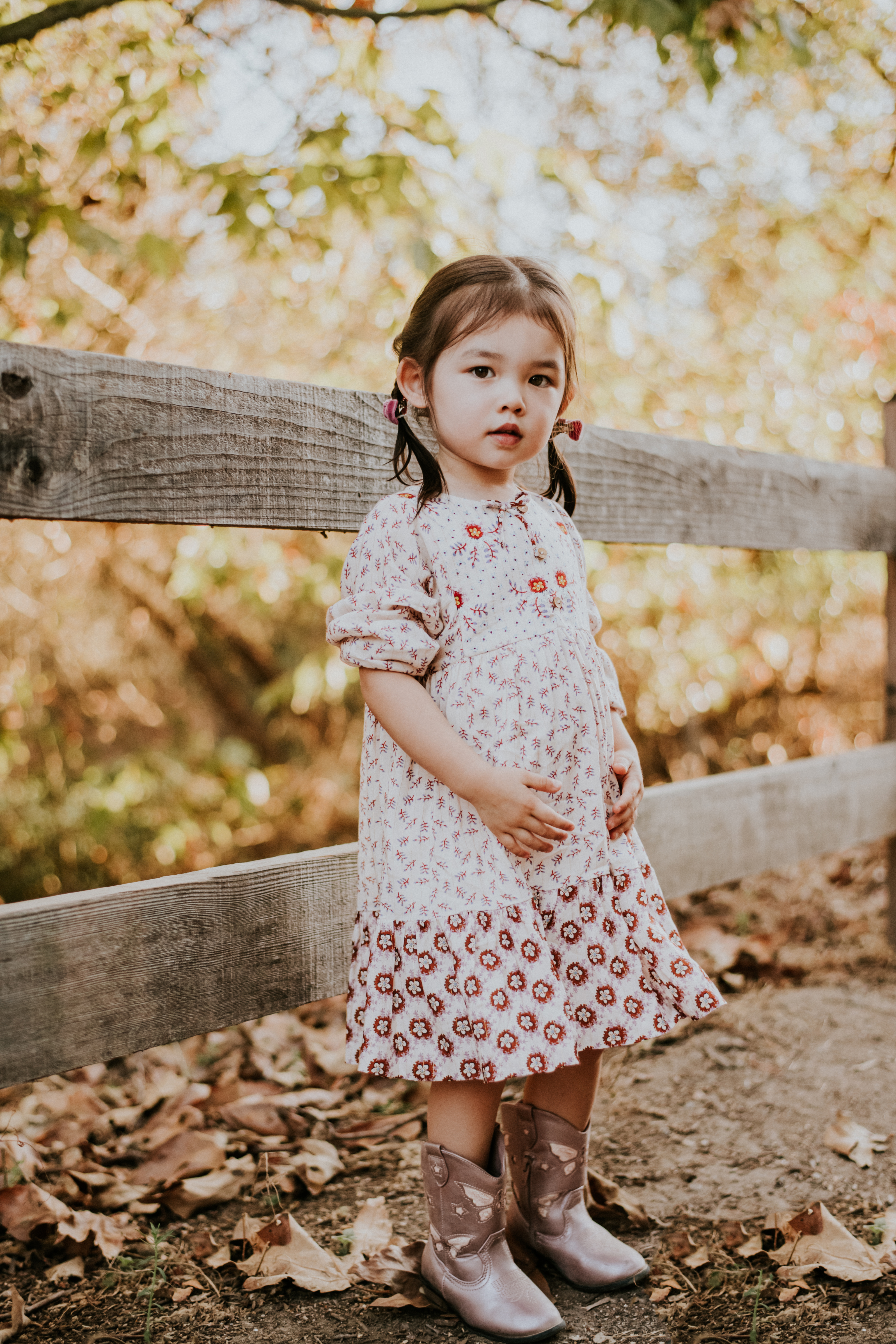 child posed by fence in the fall family photography los angeles california