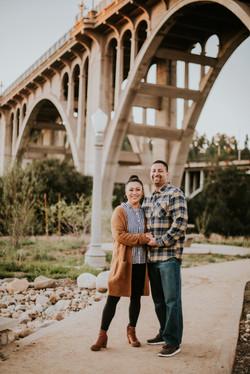 mom and dad posed under bridge fall photos family photography pasadena california