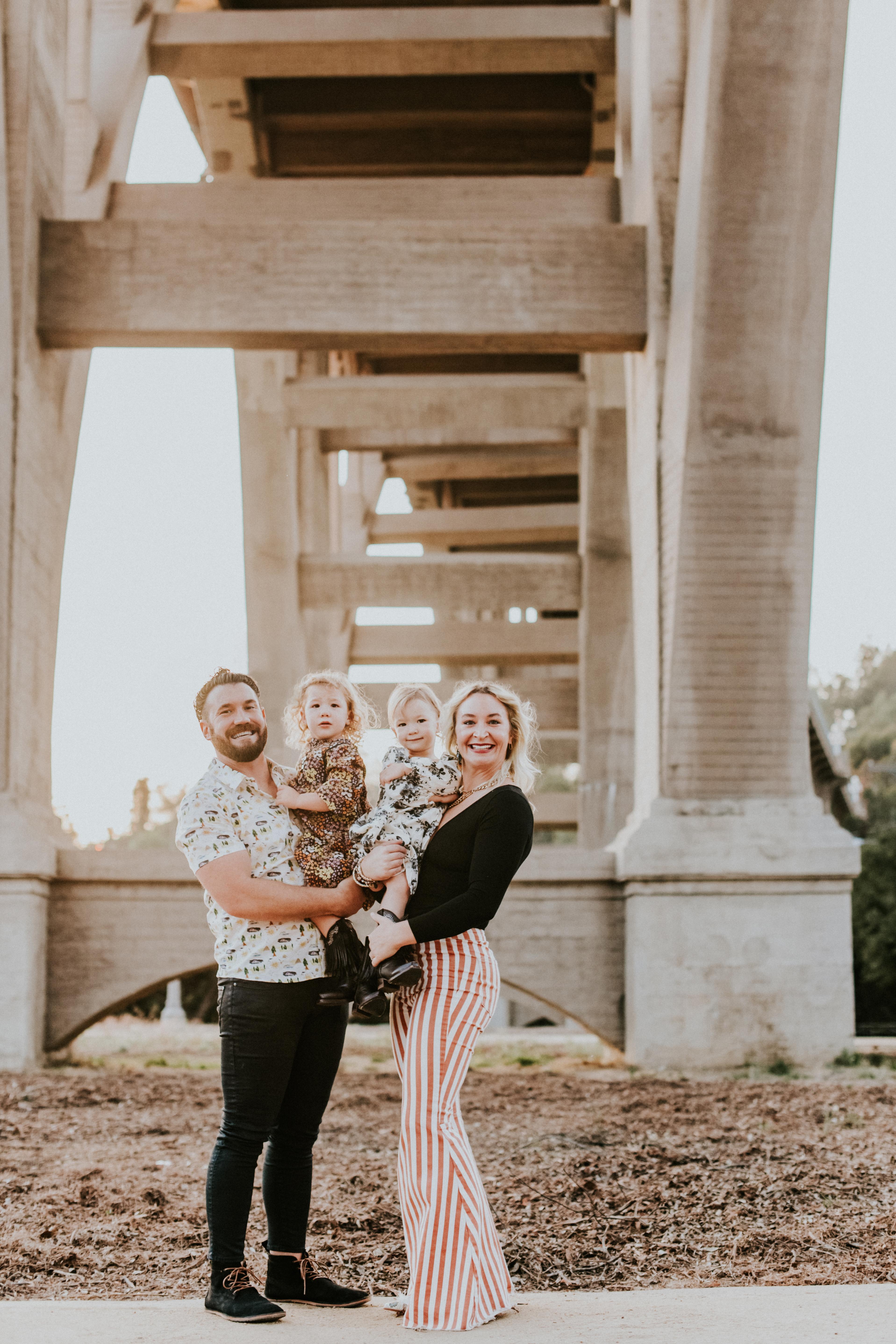 family posed under bridge family photography pasadena california