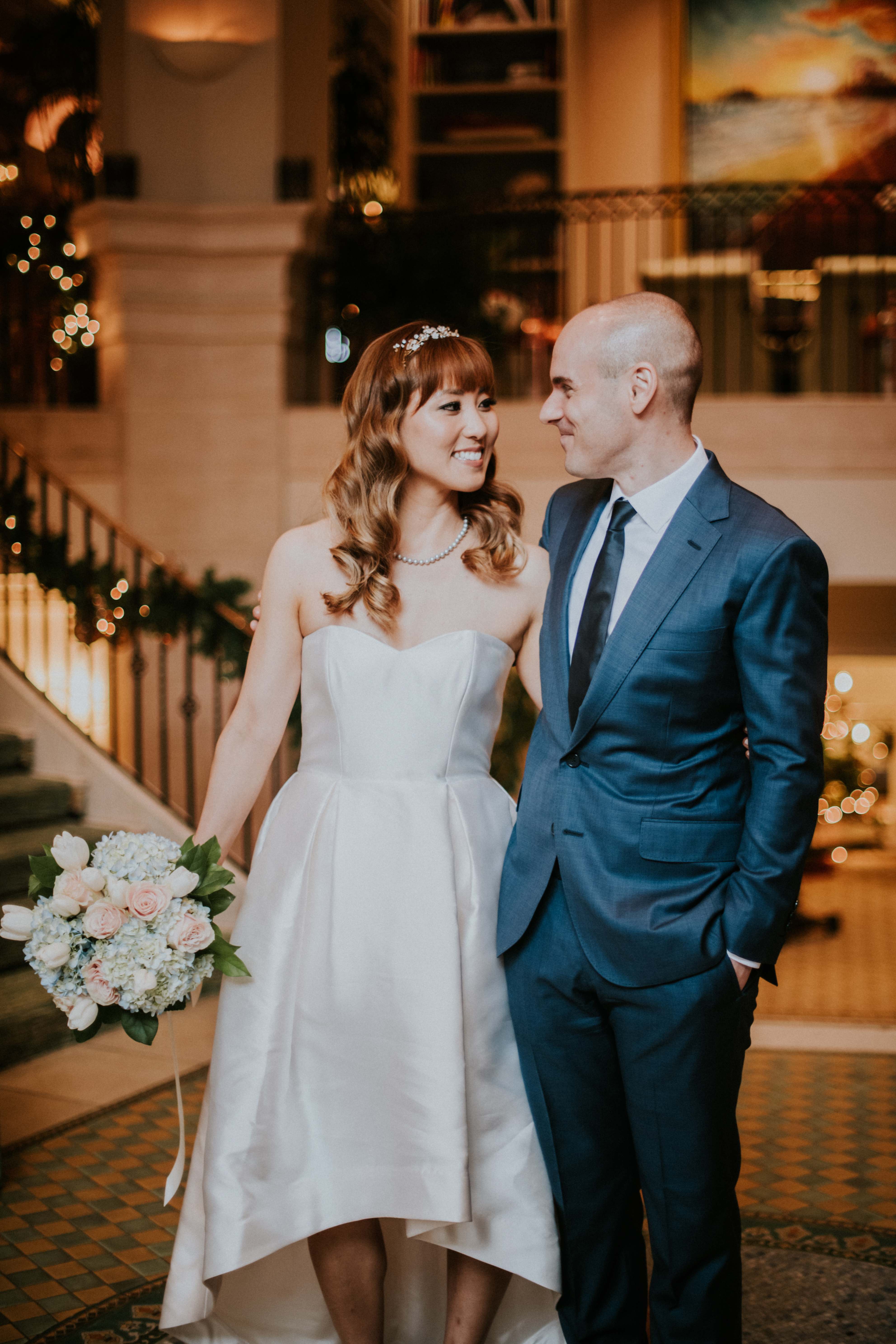 bride and groom posed at hotel lobby wedding day photography california wedding hotel casa del mar