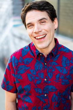 los angeles theatrical commercial headshot for male comedy actor in hawaiian shirt city backdrop
