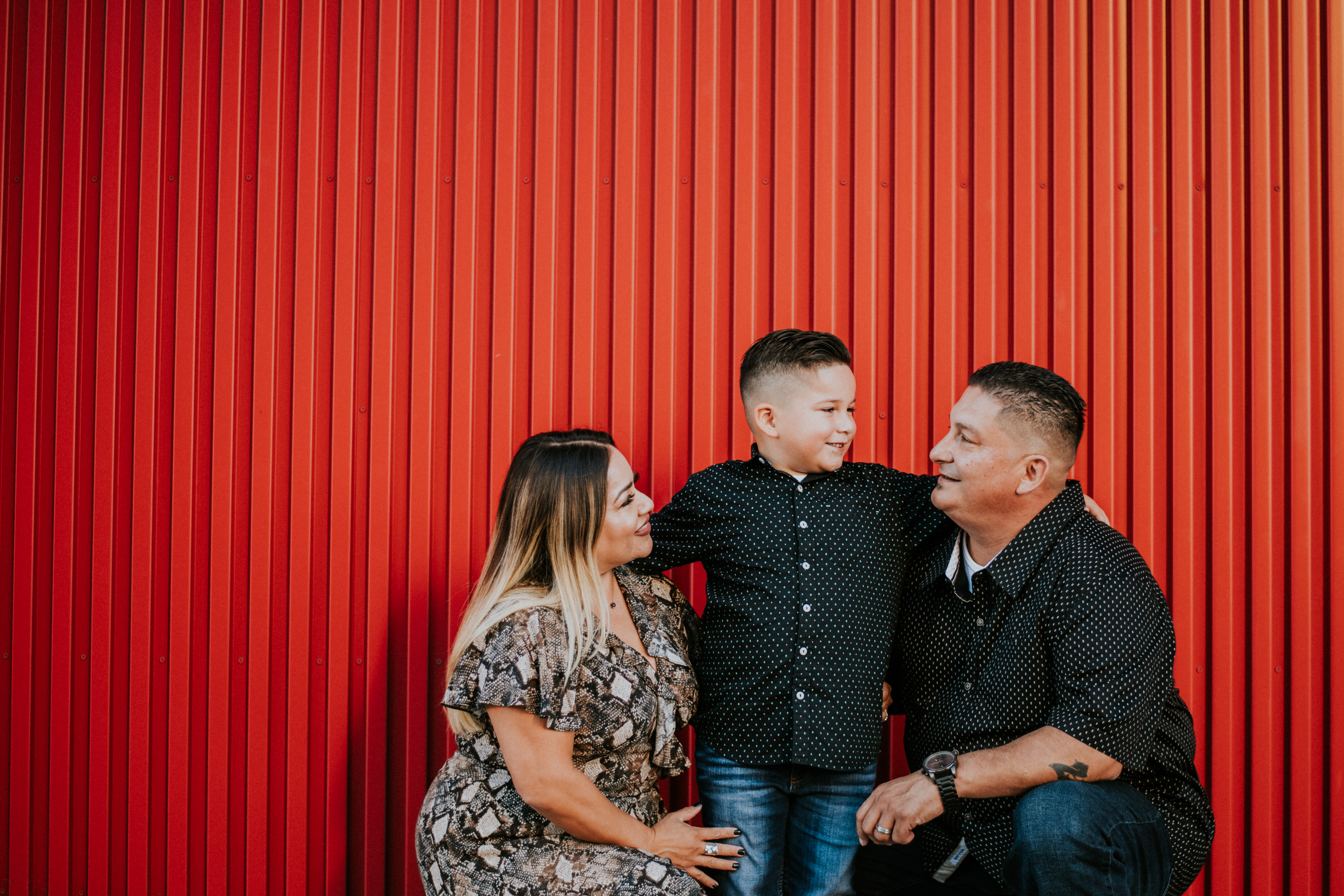 family posed in front of city wall family photography los angeles california